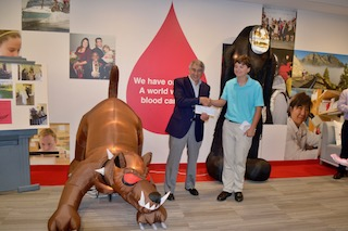 Leukemia & Lymphoma Society CEO Dr. Louis DeGennaro thanked Briarcliff's Robbie Beard for raising funds for the cause.
