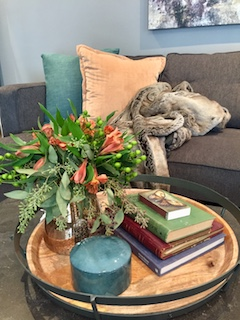 Instead of the typical orange and green, try introducing subtle coppers and deep teals to give your home a fall feel.