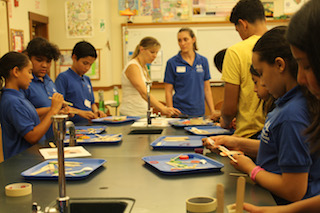 Hudson River Scholars and mentors enjoy a hands-on science class building catapults.
